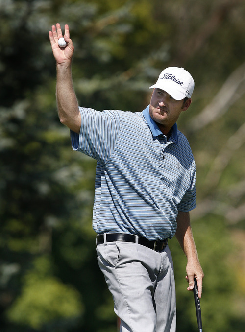 Scott Sommerdorf  |  The Salt Lake Tribune              James Drew reacts to the crowd's applause after sinking a birdie putt on 18 to go 19 under par at the Utah Open, Sunday, August 26, 2012.