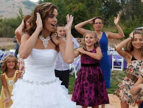 Trent Nelson  |  The Salt Lake Tribune Jen Comer dances the Macarena at her wedding reception in Huntsville, Utah, Aug. 18, 2012.
