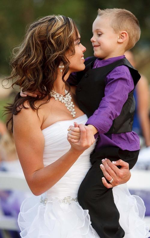 Trent Nelson  |  The Salt Lake Tribune Jen Comer dances with her son, T.J. Carver, at her wedding reception. Comer married Daniel Comer in Huntsville, Utah, Aug. 18, 2012.