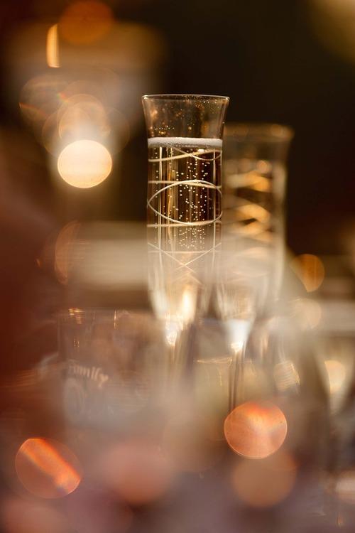 Trent Nelson  |  The Salt Lake Tribune Glasses of champagne glisten at the wedding reception for Jen and Daniel Comer in Huntsville, Utah, Aug. 18, 2012.