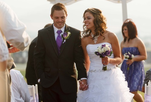 Trent Nelson  |  The Salt Lake Tribune Jen Comer walks with her husband, Daniel Comer, after their wedding ceremony in Huntsville, Utah, Aug. 18, 2012.