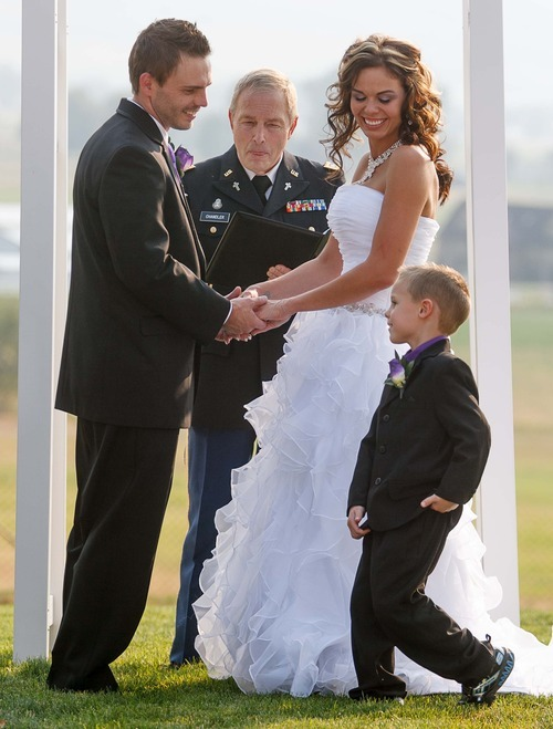 Trent Nelson  |  The Salt Lake Tribune T.J. Carver brings rings to his mother, Jen Comer, and her groom, Daniel Comer, at their wedding in Huntsville, Utah, Aug. 18, 2012. Retired Army Chaplain Charles Chandler, at center, performed the ceremony.