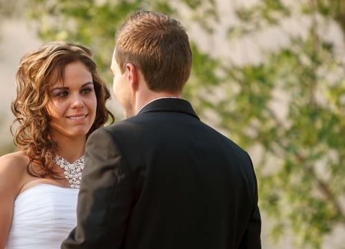 Trent Nelson  |  The Salt Lake Tribune Jen Comer emotionally bites her lip as her husband, Daniel Comer, takes his vows at their wedding ceremony in Huntsville, Utah, Aug. 18, 2012.