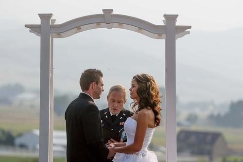 Trent Nelson  |  The Salt Lake Tribune Jen Carver and Daniel Comer are married in Huntsville, Utah, Aug. 18, 2012. The bride's boss, retired Army Chaplian Charles Chandler, performed the ceremony.