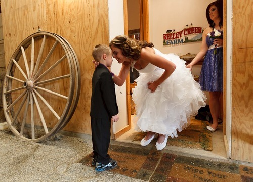 Trent Nelson  |  The Salt Lake Tribune Jen Carver shares a moment with her son, T.J. Carver, before marrying Daniel Comer in Huntsville, Utah, Aug. 18, 2012. Maid of Honor Janae Davis is at right.