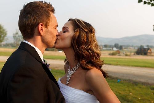 Trent Nelson  |  The Salt Lake Tribune Jen Comer kisses her husband Daniel Comer at their wedding reception in Huntsville, Utah, Aug. 18, 2012.