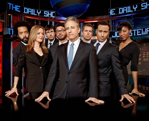 This undated image released by Comedy Central shows, from left, Wyatt Cenac, Samantha Bee, John Oliver, Al Madrigal, Jon Stewart, Jason Jones, Aasif Mandvi and Jessica Williams from