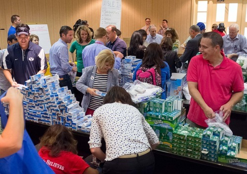 Trent Nelson  |  The Salt Lake Tribune Delegates from Utah, Arizona and Hawaii assemble hurricane aid packets at the Hilton Hotel in Tampa, Florida, Monday, August 27, 2012, the day before the Republican National Convention kicks off.