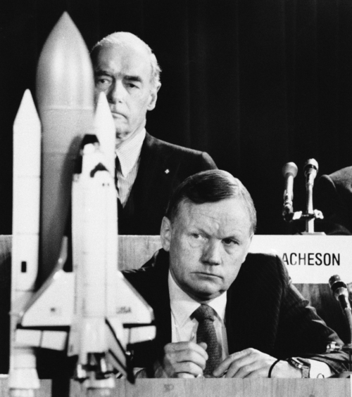 FILE - In this Feb. 11, 1986 file photo, former astronaut Neil Armstrong, a member of the presidential panel investigating the Space Shuttle Challenger explosion, listens to testimony before the commission in Washington,  David Acheson, a commission member, listens in the background. A model of the shuttle sits on the table. The family of Neil Armstrong, the first man to walk on the moon, says he has died at age 82. A statement from the family says he died following complications resulting from cardiovascular procedures. It doesn't say where he died. Armstrong commanded the Apollo 11 spacecraft that landed on the moon July 20, 1969. He radioed back to Earth the historic news of