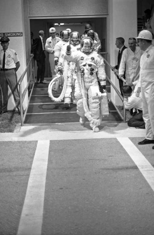 FILE - In this July 16, 1969 file photo, Apollo 11 commander Neil Armstrong gives a thumbs up signal as the three Apollo astronauts walk to the transfer van en route to the Saturn Five rocket ready to blast off for the moon, July 16, 1969, Cape Kennedy, Fla.  The family of Neil Armstrong, the first man to walk on the moon, says he has died at age 82. A statement from the family says he died following complications resulting from cardiovascular procedures. It doesn't say where he died. Armstrong commanded the Apollo 11 spacecraft that landed on the moon July 20, 1969. He radioed back to Earth the historic news of