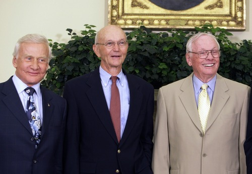 In this July 20, 2009, photo, Buzz Aldrin, left, Michael Collins, center, and Neil Armstrong stand in the Oval Office at the White House in Washington, on the 40th anniversary of the Apollo 11 moon landing. Neil Armstrong was a quiet self-described nerdy engineer who became a global hero when as a steely-nerved pilot he made