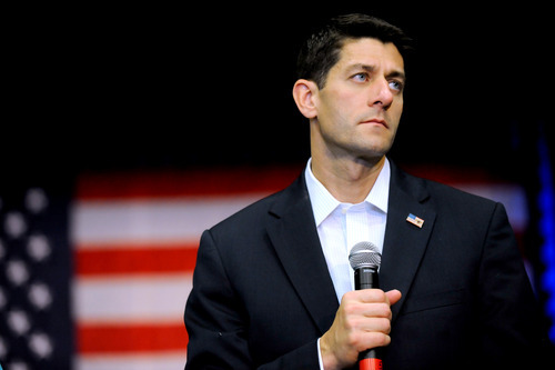 Republican vice presidential candidate, Rep. Paul Ryan, R-Wis., listens to question during a campaign event at Partnership for Defense Innovation in Fayetteville, N.C., Thursday, Aug. 23, 2012. (AP Photo/Sara D. Davis)