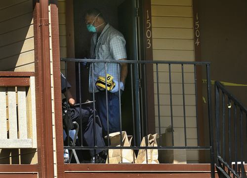 Scott Sommerdorf  |  The Salt Lake Tribune              With bags of evidence sitting on the porch, Police investigators search an apartment at 6999 S. State Street, #1503, for further evidence of a murder, Sunday, August 26, 2012 in Midvale.