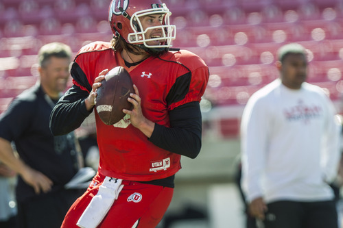 Chris Detrick  |  The Salt Lake Tribune Utah Utes quarterback Jordan Wynn (3) looks to throw the ball during a practice at Rice-Eccles Stadium Tuesday April 17, 2012.