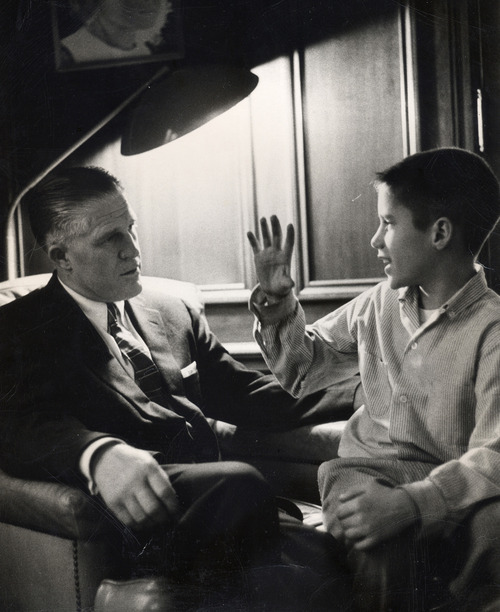 This 1957 family photo provided by Romney for President, Inc., shows George Romney, left, and son Mitt Romney, right, in their Detroit, Mich., home. (AP Photo/Romney Family Via Romney For President, Inc.)