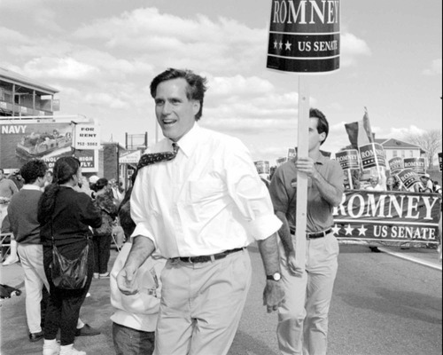 FILE - In this Oct. 10, 1994, file photo, Republican U.S. senatorial candidate Mitt Romney greets supporters at the Columbus Day parade in Worcester, Mass., following his father's path into politics. (AP Photo/C.J. Gunther, File)