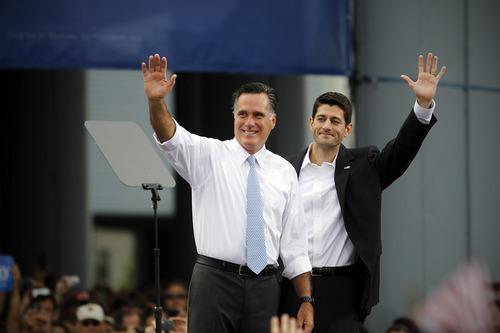 Republican presidential candidate, former Massachusetts Gov. Mitt Romney, left, introduces his vice presidential running mate, Wisconsin Rep. Paul Ryan, Saturday, Aug. 11, 2012 in Norfolk, Va.   (AP Photo/Virginian-Pilot, Amanda Lucier)