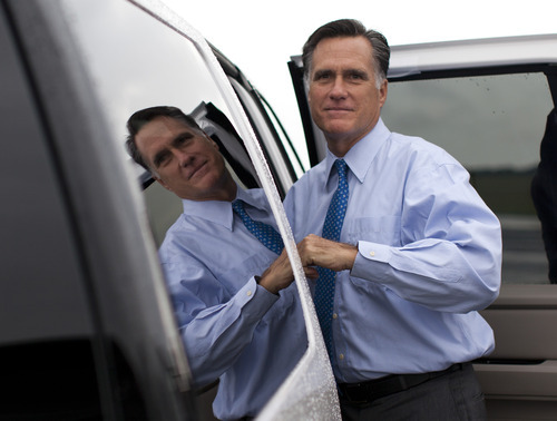 Republican presidential candidate, former Massachusetts Gov. Mitt Romney gets into his car to attend a fundraising event on Saturday, Aug. 18, 2012 in Nantucket, Mass.  (AP Photo/Evan Vucci)