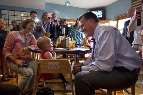 Republican presidential candidate, former Massachusetts Gov. Mitt Romney makes a stop at Millie's to talk with voters before attending a fundraising event on Saturday, Aug. 18, 2012 in Nantucket, Mass.  (AP Photo/Evan Vucci)