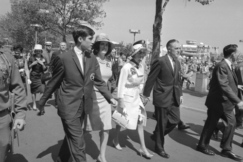 From right, Michigan Governor George Romney, his wife Lenore, daughter Lynn and son Mitt walk along a street at the World's Fair en route to the General Motors Pavilion in the Queens borough of New York, May 18, 1964.  (AP Photo)