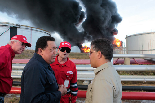 In this photo provided by Miraflores Presidential Press Office, Venezuela's president Hugo Chavez, second from left, speaks with Venezuela's Vice President Elias Jaua, as Venezuela's Oil Minister and President of Petroleos de Venezuela, S.A., PDVSA,  Rafael Ramirez, left, stands during a visit to the Amuay refinery near Punto Fijo, Venezuela, Sunday, Aug. 26, 2012. A huge explosion rocked Venezuela's biggest oil refinery early Saturday killing at least 39 people and injuring more than 80 in Venezuela's deadliest refinery blast ever. (AP Photo/Miraflores Presidential Office)
