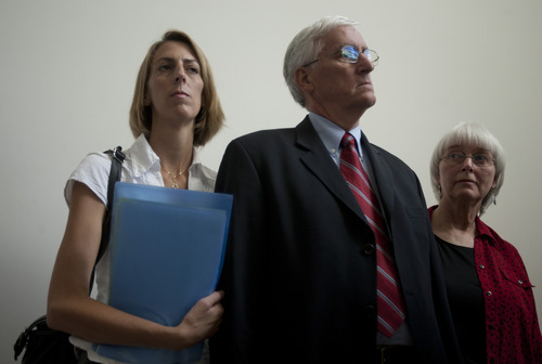 Cindy, right, and Craig Corrie, the parents of Rachel Corrie, a pro-Palestinian activist who was killed by an Israeli bulldozer in Gaza in 2003, stand together with their daughter Sarah after the district court's ruling in Haifa, Israel, Tuesday, Aug. 28, 2012. An Israeli court on Monday rejected a lawsuit brought against the military by the parents of a U.S. activist crushed to death by an army bulldozer during a 2003 demonstration, ruling the army was not at fault for her death. The bulldozer driver has said he didn't see 23-year-old Rachel Corrie, who was trying to block the vehicle's path during a demonstration in the Gaza Strip against the military's demolition of Palestinian homes. The military deemed her March 2003 death to be accidental, but Corrie's parents were not satisfied by the army investigation and filed a civil lawsuit two years later. (AP Photo/Ariel Schalit)