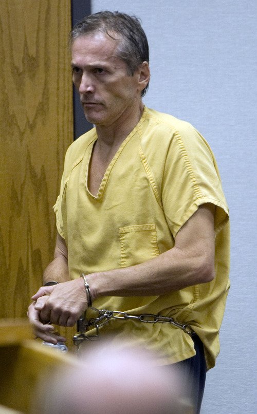 Scott G. Winterton     Pool photo Martin Joseph MacNeill walks to the podium as he makes his initial appearance Monday, Aug. 27, 2012 before Judge Samuel D. McVey in Provo Utah on charges linking him to the murder of his wife Michele MacNeill.