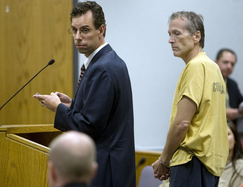 Scott G. Winterton     Pool photo Martin Joseph MacNeill, right, stands with his Attorney Randall Spencer as he makes his initial appearance Monday, Aug. 27, 2012 before Judge Samuel D. McVey in Provo Utah on charges linking him to the murder of his wife Michele MacNeill.