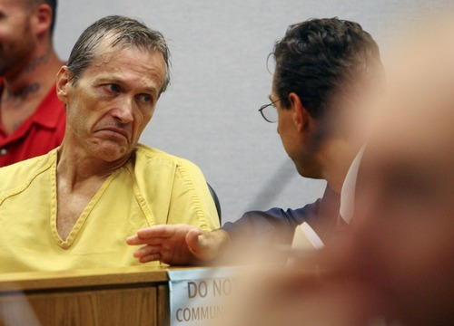 Scott G. Winterton     Pool photo Martin Joseph MacNeill, left, talks with his Attorney Randall Spencer prior to making his initial appearance Monday, Aug. 27, 2012 before Judge Samuel D. McVey in Provo Utah on charges linking him to the murder of his wife Michele MacNeill.