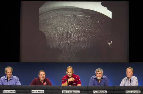 NASA scientists comment on the newest  image of the tracks left by NASA's Curiosity rover on the surface of Mars at NASA's Jet Propulsion Laboratory in Pasadena, Calif., Monday, Aug. 27, 2012. From left: Dave Lavery, Program Executive for Solar System Exploration at NASA Headquarters, Mike Malin, imaging scientist for the Mars Science Laboratory, John Grotzinger, MSL project scientist, California Institute of Technology, Paul Mahaffy, NASA Goddard Space Flight Center, and Dr. Chad Edwards, Chief Telecommunications Engineer for the Mars Exploration Program at JPL. The Mars image was taken by a front Hazard-Avoidance camera, which has a fisheye lens.  (AP Photo/Damian Dovarganes)