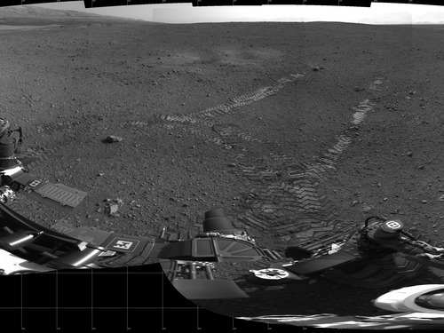 This 360-degree panorama provided by NASA Wednesday Aug. 22, 2012 shows evidence of a successful first test drive for NASA's Curiosity rover. The rover made its first move, Wednesday, going forward about 15 feet (4.5 meters), rotating 120 degrees and then reversing about 8 feet (2.5 meters). Curiosity is about 20 feet (6 meters) from its landing site, now named Bradbury Landing. (AP Photo/NASA)