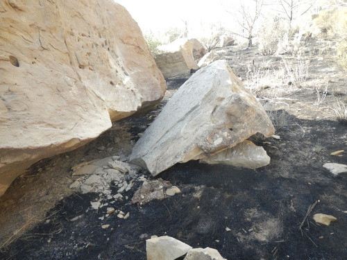 The two sandstone boulders where the Lighthouse Fire started. The boulder the size of a refrigerator crashed into one the size of a large SUV, starting the fire, officials say. Courtesy Jason Curry  |  Utah Division of Forestry