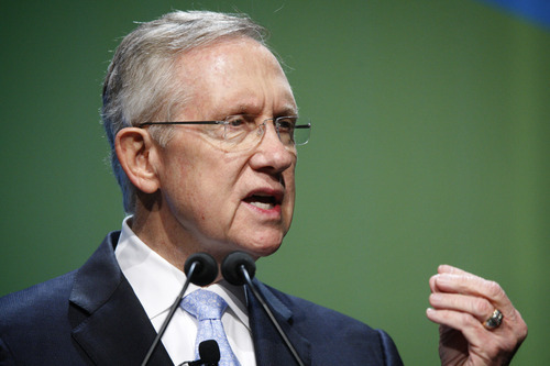 U.S. Sen. Harry Reid, D-Nev., speaks at the National Clean Energy Summit at the Bellagio in Las Vegas on Tuesday, Aug. 7, 2012. Before the beginning of the annual conference, Sen. Reid announced that U.S. wind power now has 50 gigawatts of electric generating capacity in a press conference before the summit. (AP Photo/Las Vegas Review-Journal, Jessica Ebelhar)