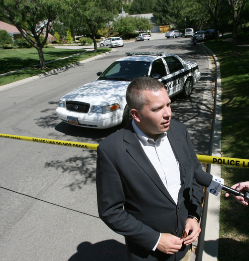 Steve Griffin | The Salt Lake Tribune   Utah County deputy attorney, Craig R. Johnson, talks to the media outside the home of plastic surgeon Joseph Berg in Orem, Utah Monday August 27, 2012. Berg, 47, was found dead about noon at his home located at 479 E. 1450 North, said Orem police Sgt. Craig Martinez. Martinez did not identify the dead woman with him. However, Johnson said it was the girlfriend Berg was convicted of kidnapping and assaulting, Lucy Schwartz.