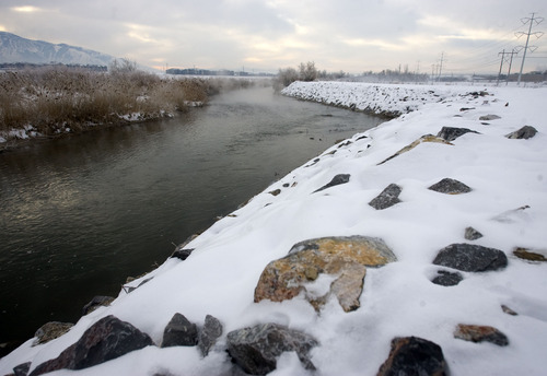 Al Hartmann  |  The Salt Lake Tribune  View of the Jordan River and west bank with rip rap rocks at about 7400 South.