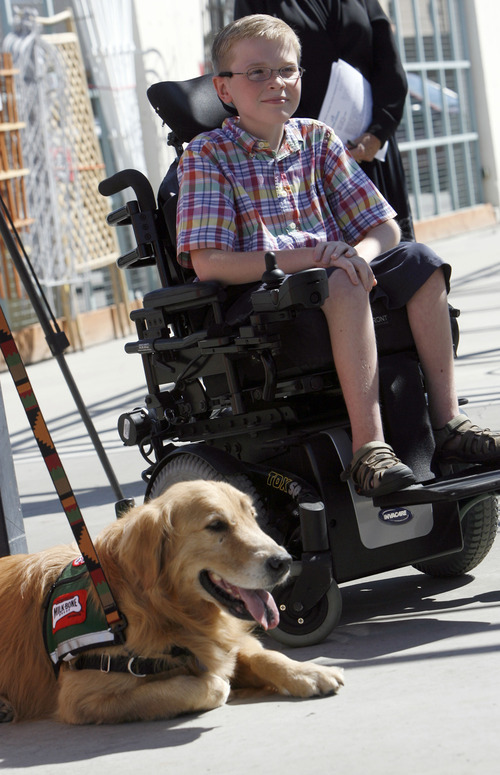 Francisco Kjolseth  |  The Salt Lake Tribune Carter Veldevere, a 6th grader from Hayden Peak Elementary in West Jordan who has spinal muscular atrophy, meets Barnsley, a spokesdog for non-profit Canine Assistants. The 10-year-old received a sponsorship from Milk-Bone and Smith's Food & Drug, and will be matched with a free service dog some time in the next year.