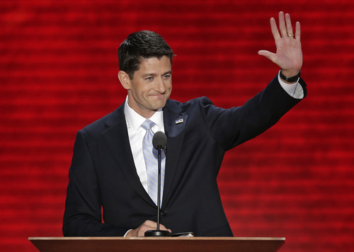 Republican vice presidential nominee, Rep. Paul Ryan waves toward the delegates during the Republican National Convention in Tampa, Fla., on Wednesday, Aug. 29, 2012. (AP Photo/J. Scott Applewhite)