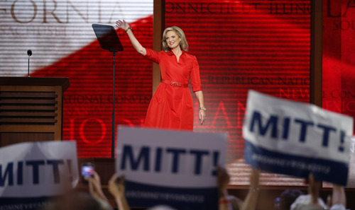 Ann Romney, wife of U.S. Republican presidential nominee Mitt Romney, waves as she walks up to the podium to address the Republican National Convention in Tampa, Fla., on Tuesday, Aug. 28, 2012. (AP Photo/Jae C. Hong)