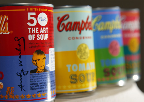 In this photograph taken Friday, August 24, 2012, new limited edition Campbell's tomato soup cans with art and sayings by artist Andy Warhol are displayed at Campbell Soup Company in Camden, N.J.  Campbell plans to introduce the special-edition cans of its condensed tomato soup bearing labels reminiscent of the pop artist's paintings at Target stores starting Sunday, Sept. 2, 2012. (Photo/Mel Evans)