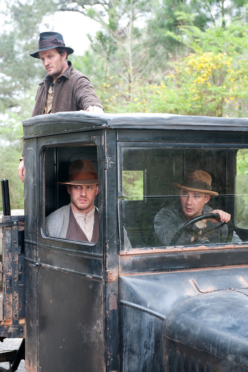 This film image released by The Weinstein Company shows from left, Jason Clarke, Tom Hardy and Shia LaBeouf in a scene from