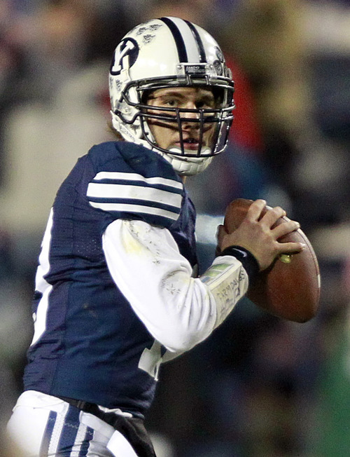 FILE - In this Nov. 12, 2011, file photo, BYU quarterback Riley Nelson looks to throw a pass against Idaho during the first half of an NCAA college football game at LaVell Edwards Stadium in Provo, Utah.  While Nelson may be a breath of fresh air at BYU, he is intent on playing to the standards of previous senior quarterbacks for the Cougars. (AP Photo/George Frey, File)