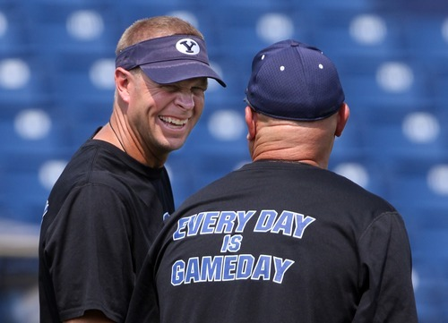 Rick Egan  | The Salt Lake Tribune   BYU head coach Bronco Mendenhall has a laugh after the football scrimmage at LaVell Edwards Stadium, Thursday, Aug. 16, 2012.