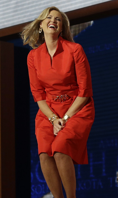 Ann Romney, wife of U.S. Republican presidential nominee Mitt Romney, reacts as he walks up to the podium to address the Republican National Convention in Tampa, Fla., on Tuesday, Aug. 28, 2012. (AP Photo/Charles Dharapak)