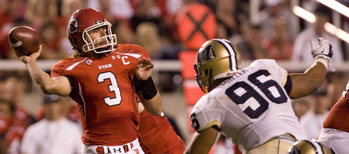 Scott Sommerdorf  |  The Salt Lake Tribune  Utah Utes quarterback Jordan Wynn (3) passes the ball under pressure from Montana State Bobcats defensive tackle Zach Minter (96) in the third quarter as Utah takes on Montana State at Rice-Eccles Stadium Thursday, Sept. 1, 2011.