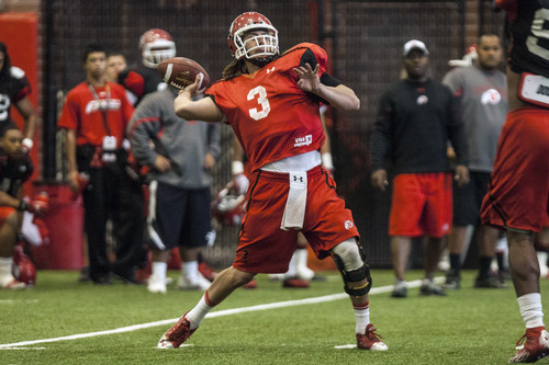 Chris Detrick  |  The Salt Lake Tribune Utah Utes quarterback Jordan Wynn (3) looks to pass the ball during a practice at the Spence Eccles Field House Thursday April 12, 2012.