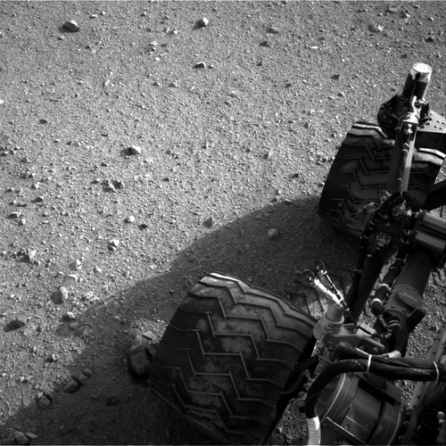 This image released by NASA on Wednesday Aug. 29,2012 shows Curiosity's wheels after it made its third drive on Mars. The six-wheel rover landed on Aug. 5, 2012 on a mission to study the red planet's environment. (AP Photo/NASA)