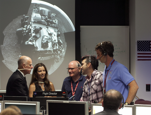 California Gov. Jerry Brown, left, tours NASA's Mars Curiosity rover mission operations center at the Jet Propulsion Laboratory in Pasadena, Calif., Wednesday, Aug. 22, 2012. From left: Gov. Brown, Jessica Samuels, Engineering team lead for Surface Operations of Mars Science Laboratory, Arthur Amador, mission manager, partially seen, and Bobak Ferdowsi, Flight Director for the Mars Science Laboratory. (AP Photo/Damian Dovarganes)