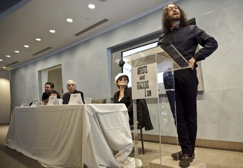 Actor and activist Mark Ruffalo, far left, Cornell University Professor Anthony Ingrafffea, second from left, and Yoko Ono, second from right, listens as Sean Lennon speaks during a press conference to launch a coalition of artists opposing hydraulic fracturing on Wednesday, Aug. 29, 2012 in New York. The formation of the group, called Artists Against Fracking, comes as New York Gov. Andrew Cuomo decides whether to allow shale gas drilling using high-volume hydraulic fracturing called hydrofracking. The group says such drilling is harmful and poses the threat of contamination. They say they want to spread awareness of the issue through