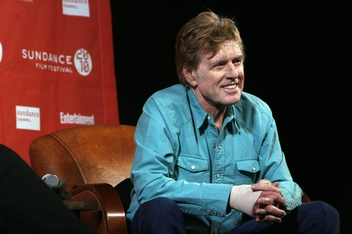 Francisco Kjolseth  |  The Salt Lake Tribune     Robert Redford, seated alongside Sundance Film Festival director John Cooper, answers questions from the media at the start of the 2010 festival.