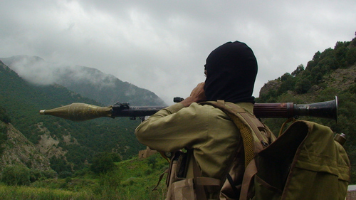 A Pakistani Taliban militant holds a rocket-propelled grenade earlier this month at the Taliban stronghold of Shawal, in Pakistani tribal region of Waziristan, Pakistan. Pakistani officials confirmed Thursday that the son of the founder of the powerful Haqqani militant network, Badruddin Haqqani, was killed in a U.S. drone strike this week. (AP Photo)
